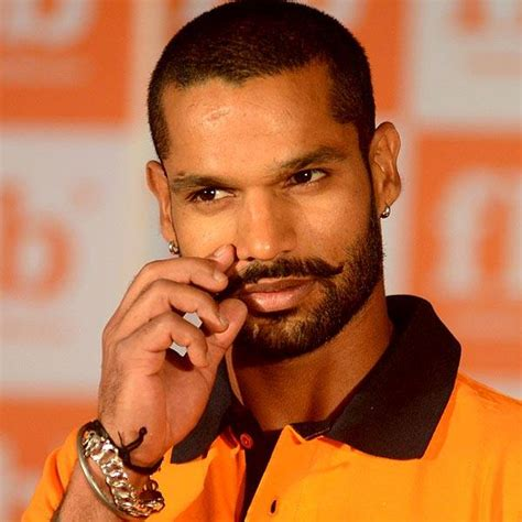 Shikhar Dhawan twirls his moustache and his bat in style